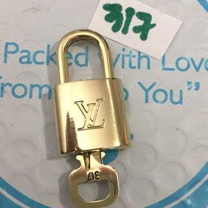 Authentic Louis Vuitton Lock and key set #317